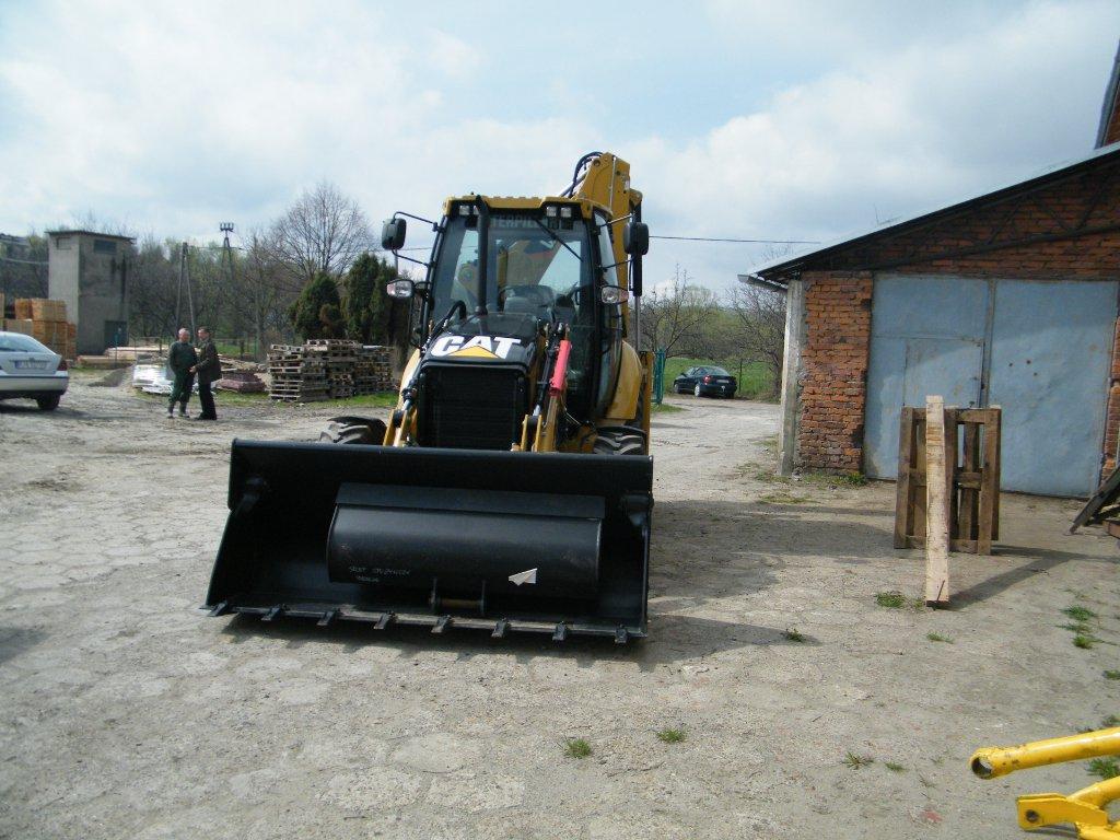 Galeria zdjęć: Dostawa fabrycznie nowej koparko ładowarki na potrzeby gospodarki wodno - ściekowej